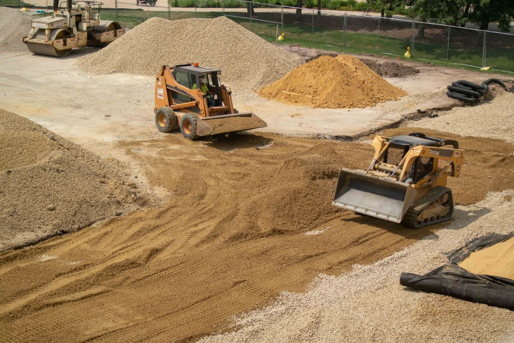 Construction crew works to expand court area